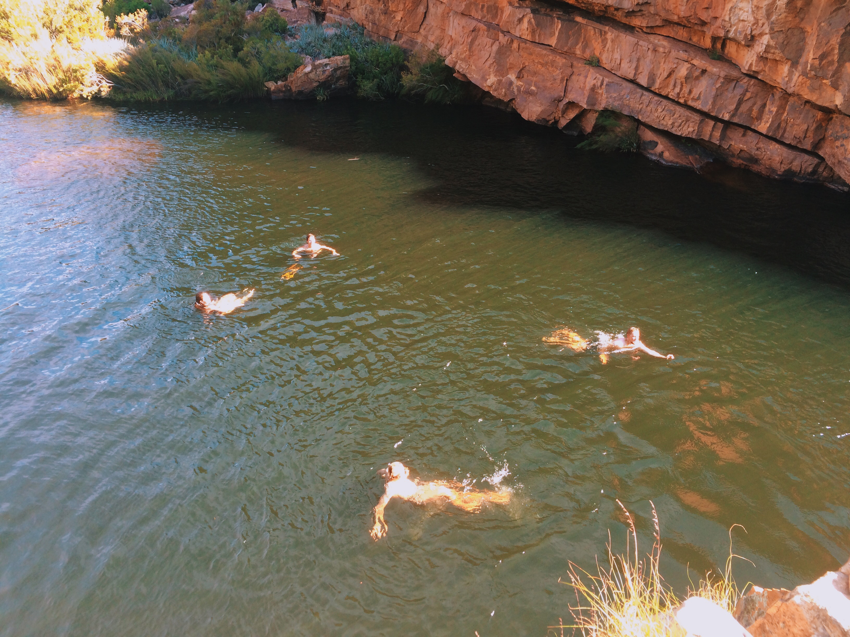 Swimmers enjoy the refreshing water after jumping from the cliffs above - Cederberg